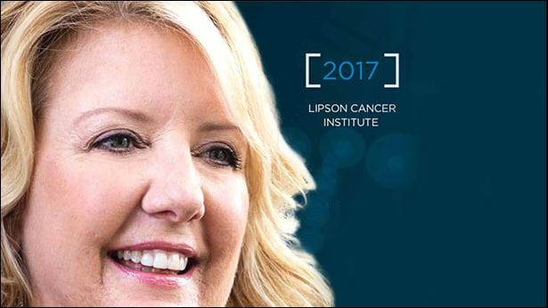 Image of woman smiling on the front cover of the Lipson Cancer Center Annual Report for 2017.