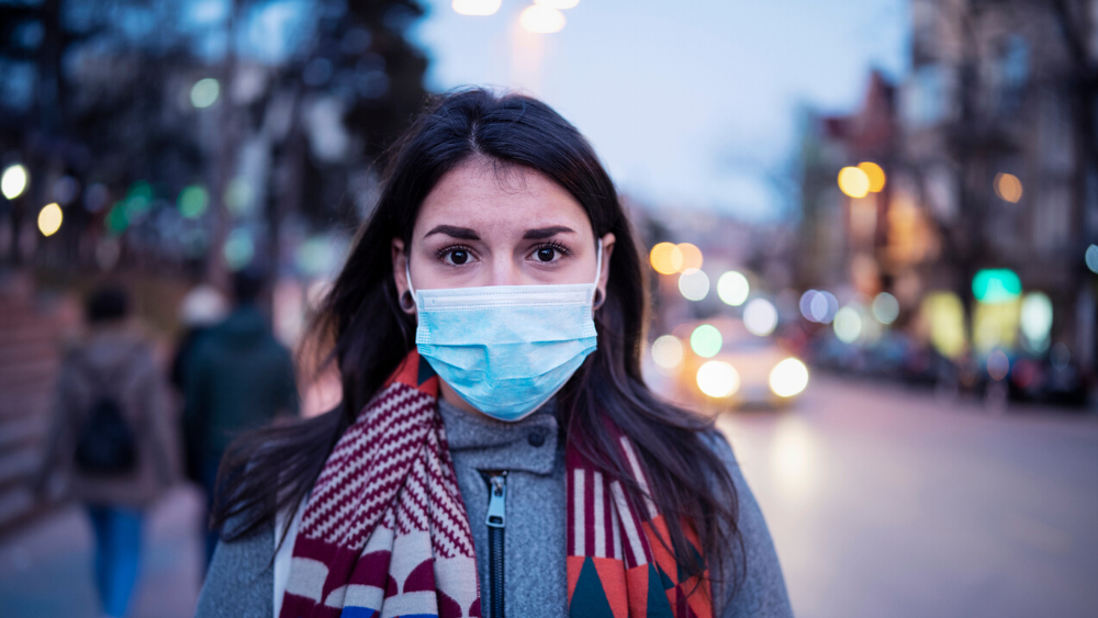 Pandemic vs. Epidemic. Woman wearing mask.