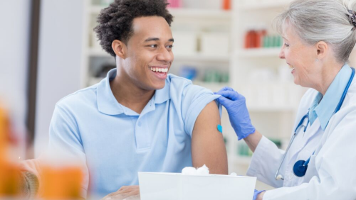 Young man getting the flu shot