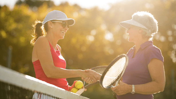 Women shaking hands after tennis
