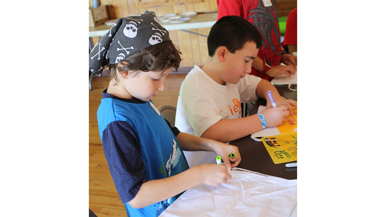 two boys doing an art activity at CompassionNet's SibsROCK! day