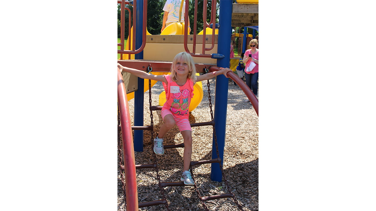 girl at playground at CompassionNet's SibsROCK! day