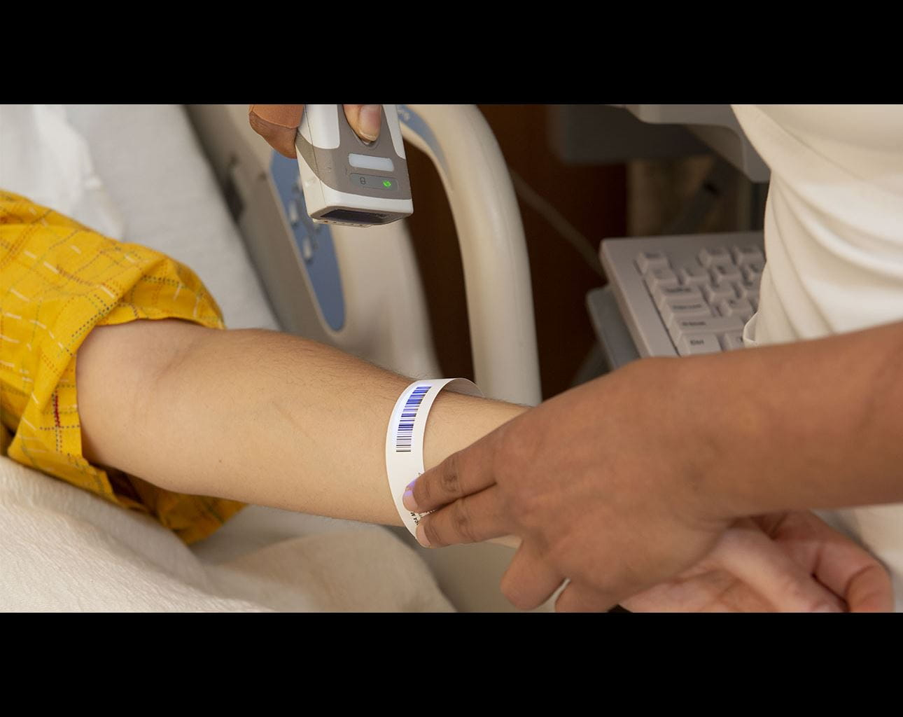 patient wrist band being scanned