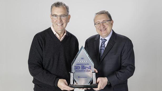 RRH leadership holding an award