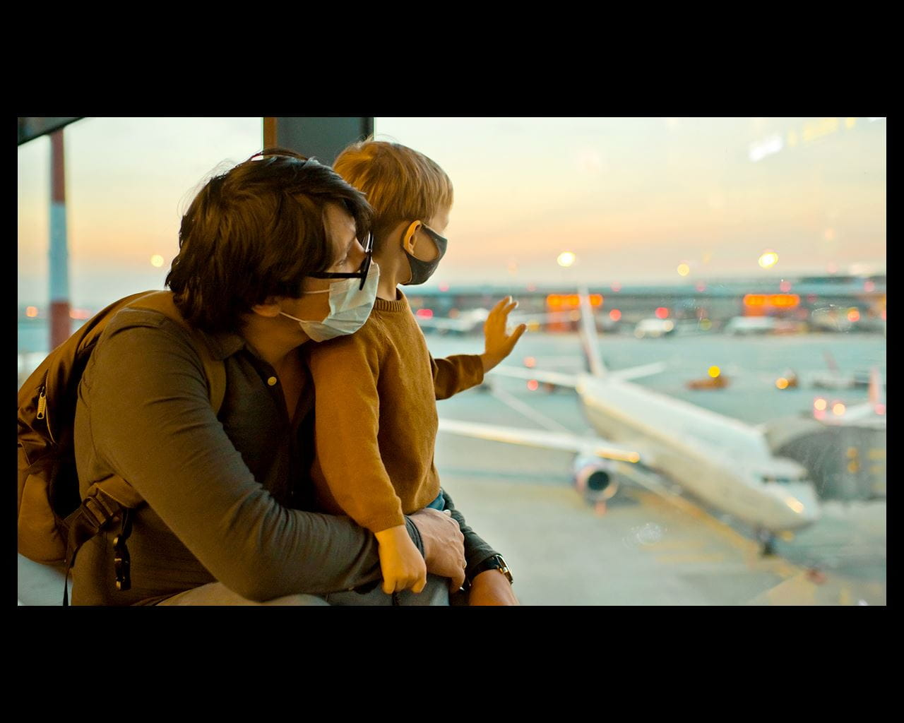 father and son delaying their flight travels