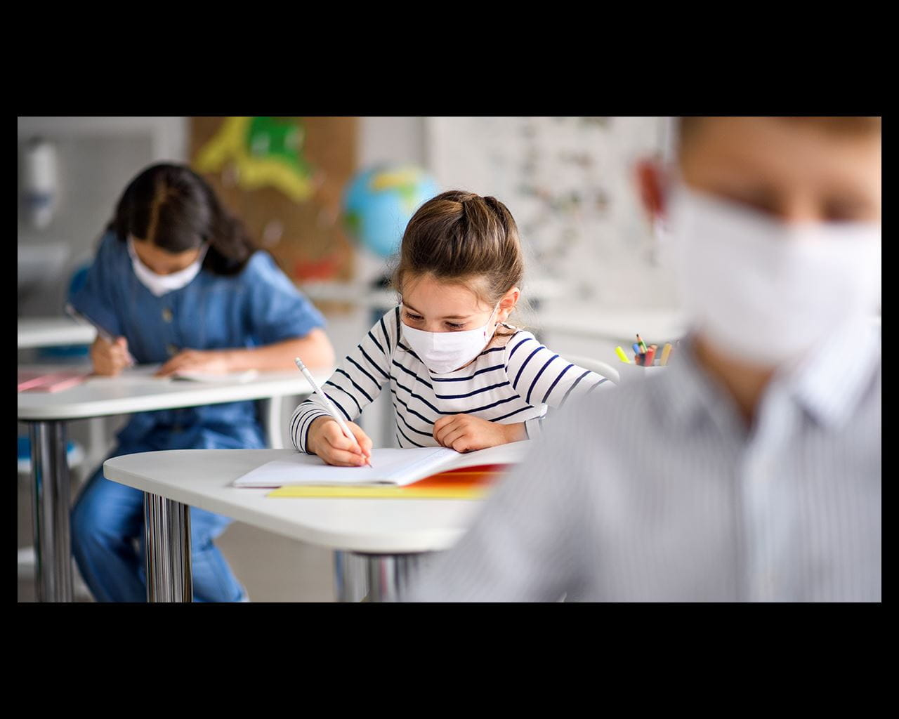 students spaced out and masked in classroom