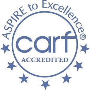 CARF accreditation seal.