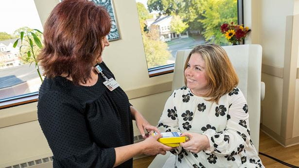 Patient Amanda thanks her Allergy doctor for her help during check-up
