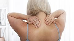 Bursitis, woman touching shoulders