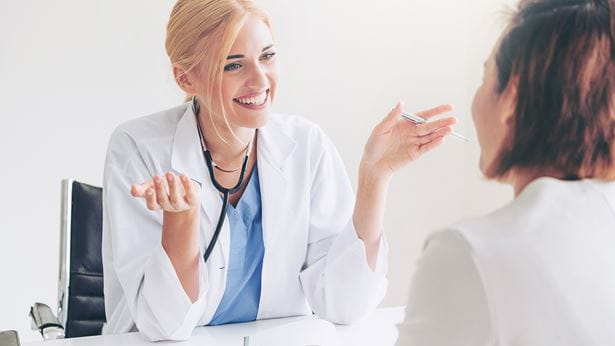 female talking with her doctor during an appointment
