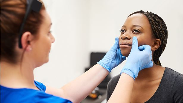 A woman being examined by a doctor