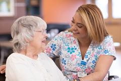 patient talking to employee