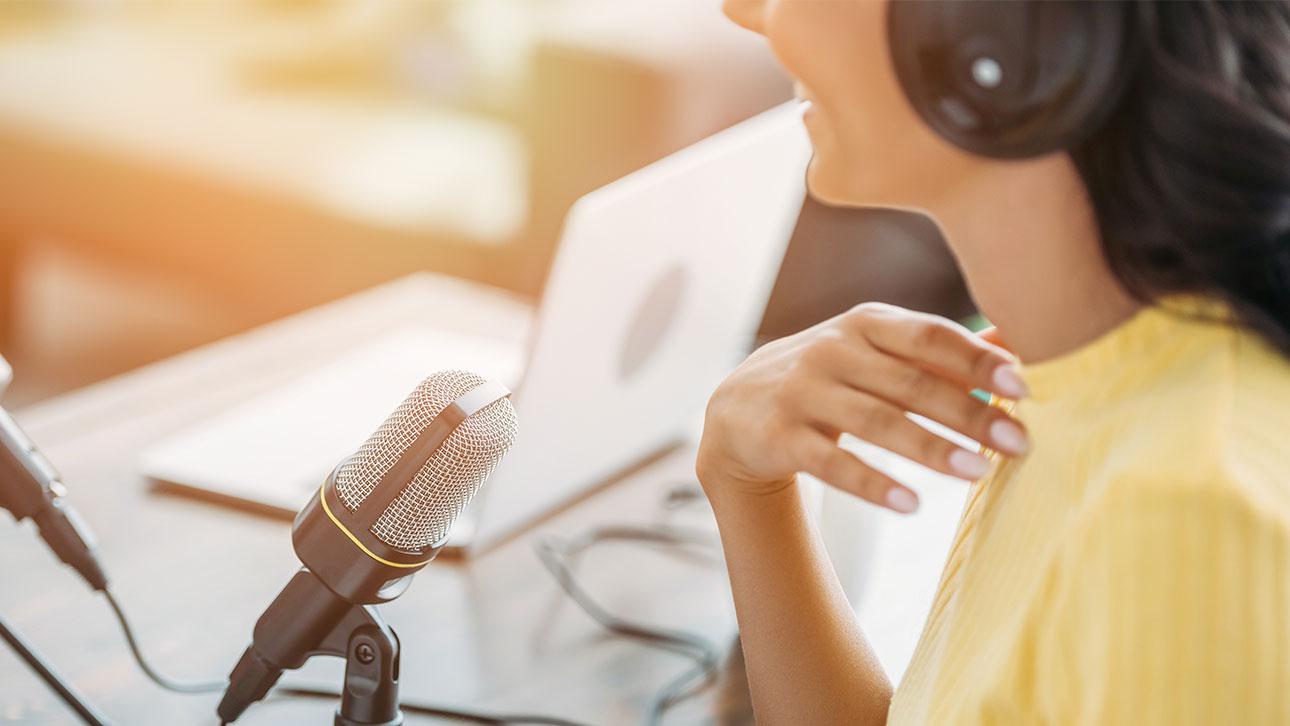 A woman recording a radio spot.