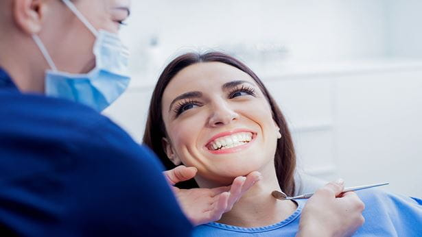 Image of a woman smiling for her dentist