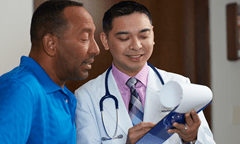 Patient reviewing documents with provider