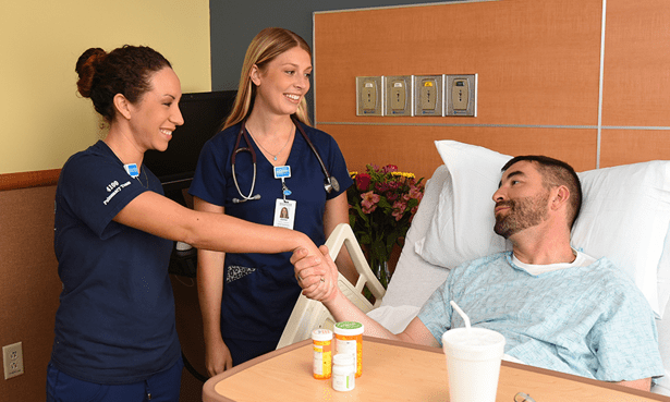 Nurses interacting with Patient